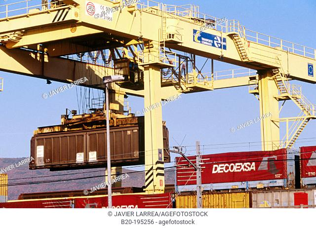 Container and crane at train station. Irun. Spain