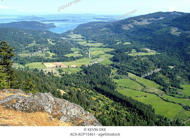 The view from Mount Maxwell overlooking the fields in the Fulford Valley. Salt Spring Island. Gulf Islands, British Columbia, Canada