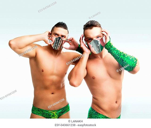 striptease dancers wearing green costumes in the studio isolated against white background