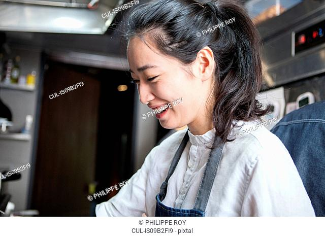 Chef in commercial kitchen smiling