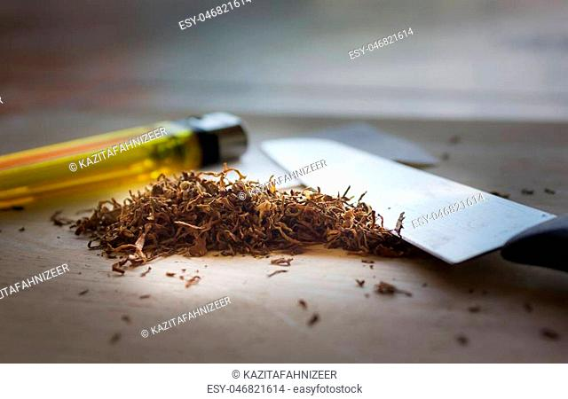 cigarette tobacco or marihuana or hemp for anti-drug concept background, cigarette tobacco or marihuana in dark for illegal and against the law concept...