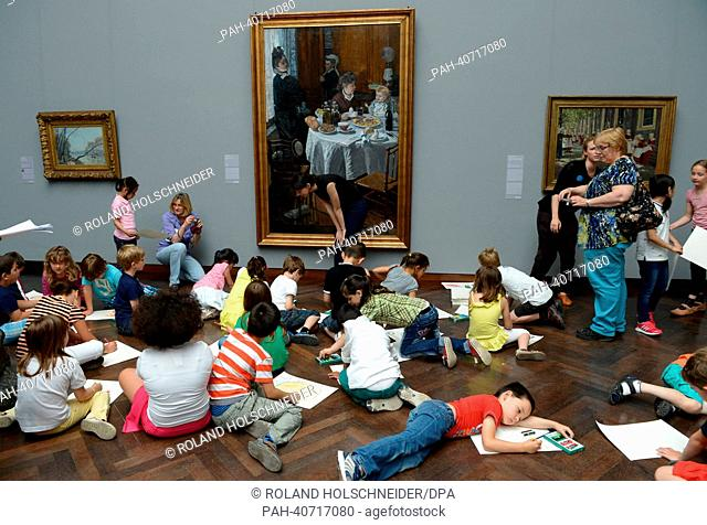 "Elementary school students paint on the floor in front of Claude Monet's """"The Luncheon"""" (1868) at the Staedel Museum in Frankfurt Main, Germany, 02 July 2013"