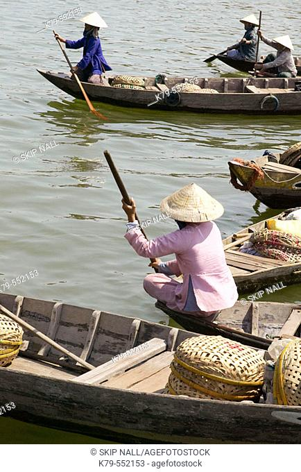 Women in boats near the market in Hoi An