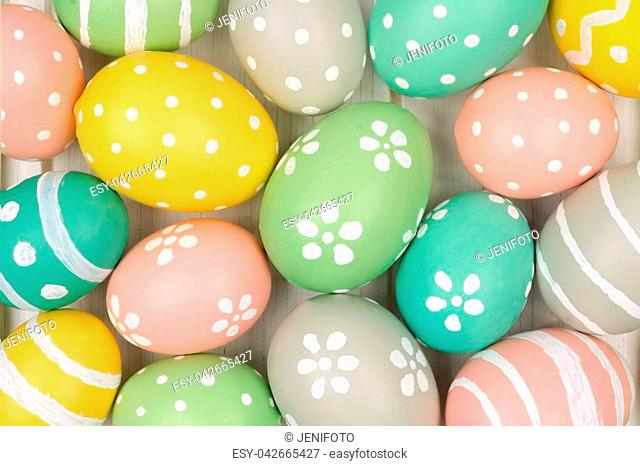 Full background of colorful, pastel, hand painted Easter eggs