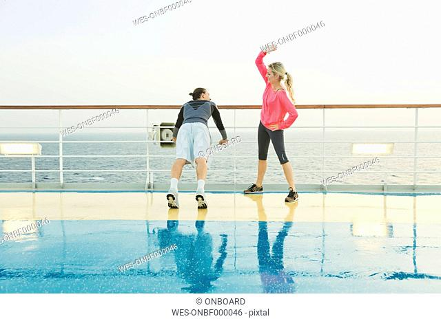 Couple doing light workout on a shipdeck, cruise ship, Mediterranean Sea