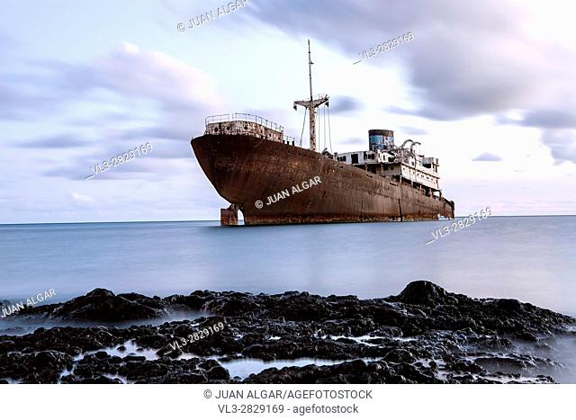 An old metal ship has frozen into the ice. Horizontal outdoors shot