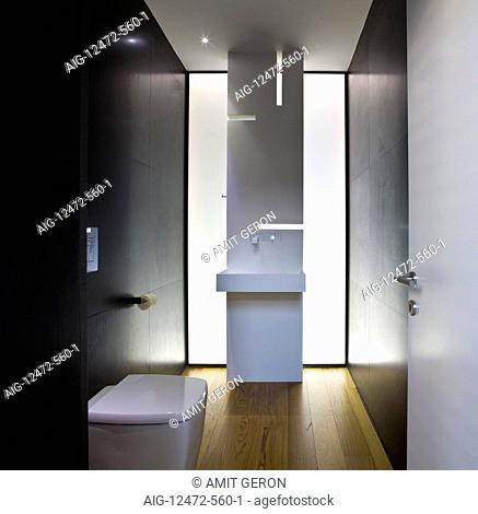 Modern bathroom with dramatic lighting and wooden floor in UP House, Hertzelia, Tel Aviv, Israel