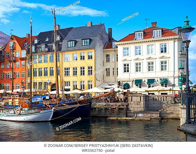 COPENHAGEN, DENMARK - AUGUST 22, 2014: The Nyhavn canal. Nyhavn is waterfront, canal and entertainment district in Copenhagen