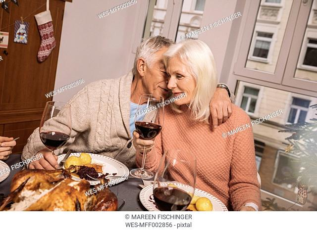 Affectionate senior couple during Christmas dinner