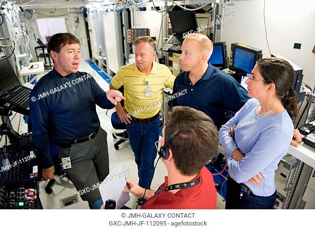 NASA astronauts Steve Lindsey (second left), STS-133 commander; along with Michael Barratt (left), Tim Kopra and Nicole Stott, all mission specialists