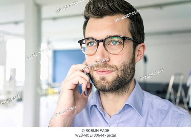 Portrait of businessman on cell phone