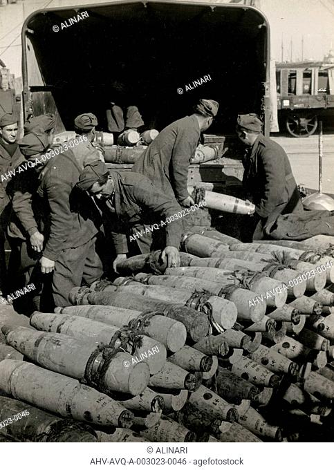 Munitions being unloaded in Naples Port from the Italian troops, shot 1944