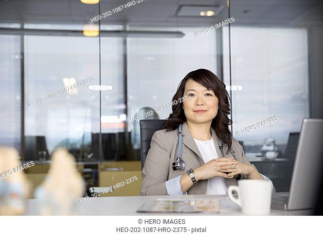 Portrait of confident doctor in conference room