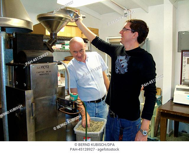 Kurt Legner (L)and his son Sebastian stand next to their coffee raoster in Las Carmelitas, Puerto Rico, 07 January 2013
