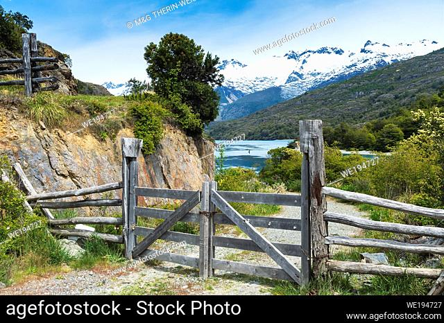 Gate along a dirt road and Castillo mountain range, Pan-American Highway, Aysen Region, Patagonia, Chile