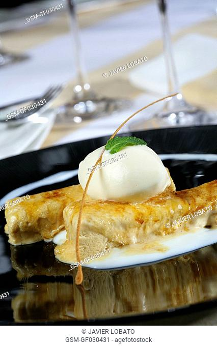 Caramelled parfait with cinnamon ice cream and rice pudding sauce