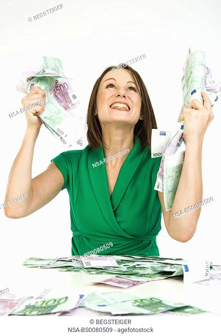 young woman with much money