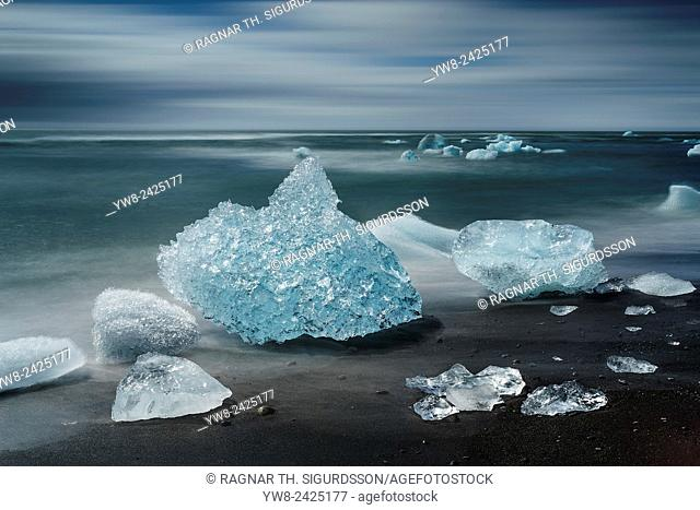 Ice formations on black sand beach. Ice comes from the Breidamerkurjokull Glacier, Vatnajokull Ice Cap, Iceland