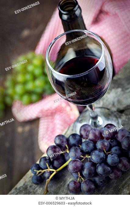 Wine concept. Food and drink background with red wine, fresh grapes and wine bottle