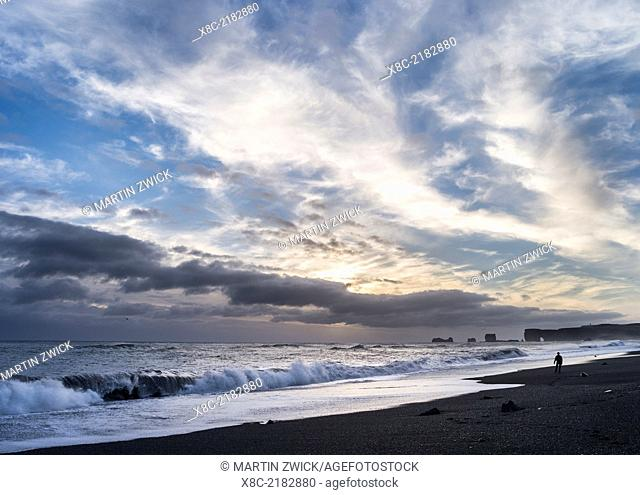 Coast of the North Atlantic near Vik y Myrdal during winter, view towards the stacks and sea arch at cape Dyrholaey. europe, northern europe, scandinavia