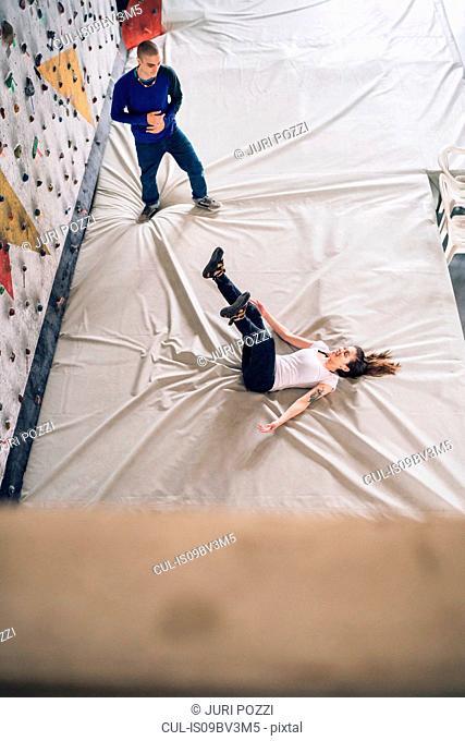 Climber falling on back on crash mat