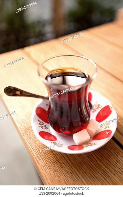 Traditional Turkish tea cup on the table in Grand Bazaar, Sultanahmet, Istanbul, Turkey,
