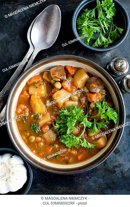 Bowl of stew with herbs
