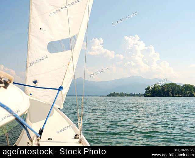 Sailing on lake Chiemsee. Lake Chiemsee in the Chiemgau. The foothills of the Bavarian Alps in Upper Bavaria, Germany