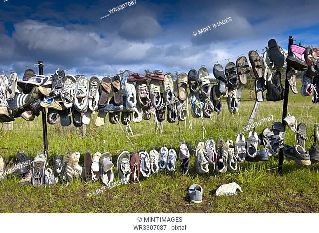 Shoes Hanging on Fence