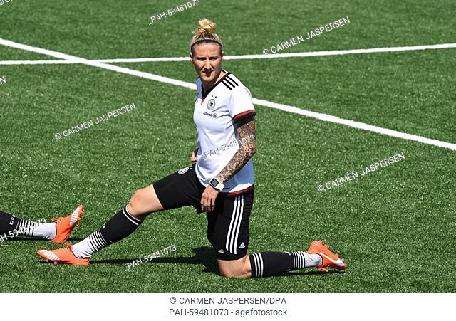 Germany's Anja Mittag stretches during a training session at the FIFA Women's World Cup 2015 at the Avenue Bois-de-Boulogne, Laval in Montreal, Canada
