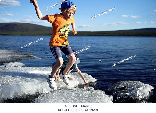 Boys playing on ice floe