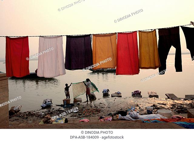clothes drying in Ganga River at Varanasi Uttar Pradesh India