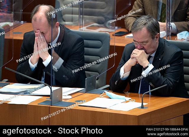 27 January 2021, North Rhine-Westphalia, Duesseldorf: Armin Laschet (CDU, r), Minister President of North Rhine-Westphalia, and his deputy Joachim Stamp (FDP