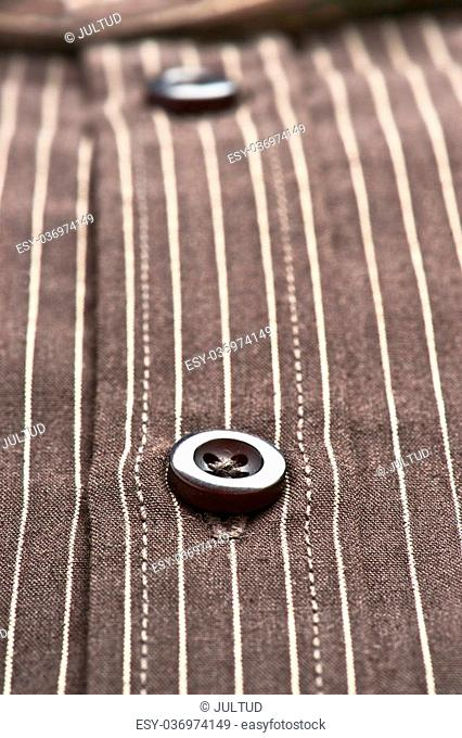 buttons, collar and sleeves of a striped shirt