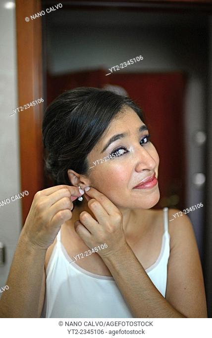 Latin bride preparing herself before the wedding