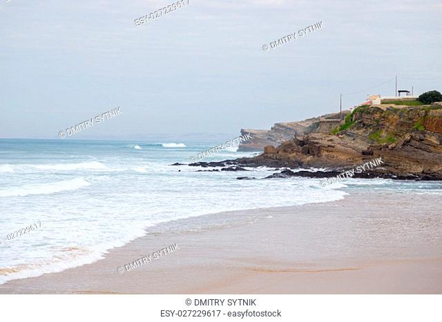 landscape atlantic coastline in europe, with surfes in cloudy day