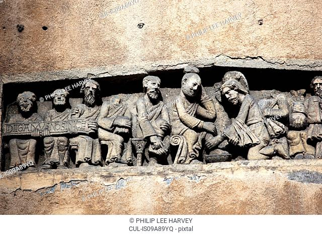 A Roman bas relief of Jesus washing the disciples feet at Place des Gras, France