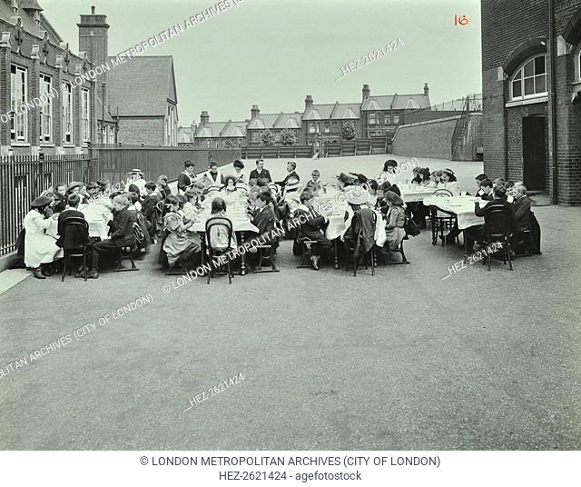 Children eating dinner at tables in the playground, Shrewsbury House Open Air School, London, 1908. Artist: Unknown
