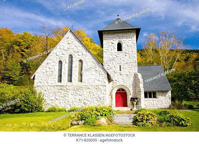 The Episcopal Church of our Savior with fall foliage color near Killington, Vermont, USA