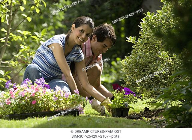 Portrait of Hispanic couple gardening