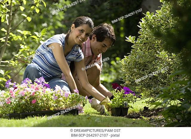 Portrait of Hispanic couple gardening