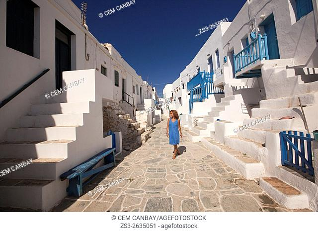 Woman walking in the narrow streets of the old town Castro, Folegandros, Cyclades Islands, Greek Islands, Greece, Europe