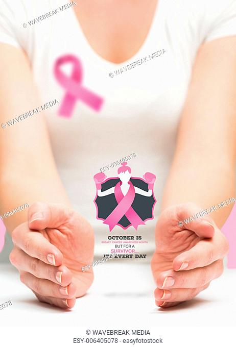 Woman presenting breast cancer awareness message