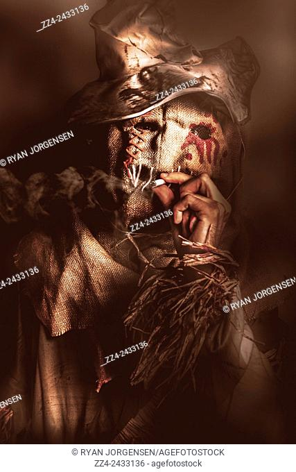 Dark horror portrait of a sinister scarecrow smoking cigarette in a dark night field. The draw of nightmares