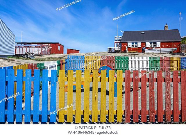 18.06.2018, Gronland, Denmark: Colorful houses of the coastal town of Ilulissat in western Greenland. The city is located on the Ilulissat Icefjord