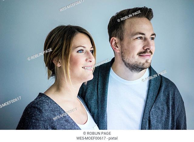 Portrait of smiling couple looking sideways