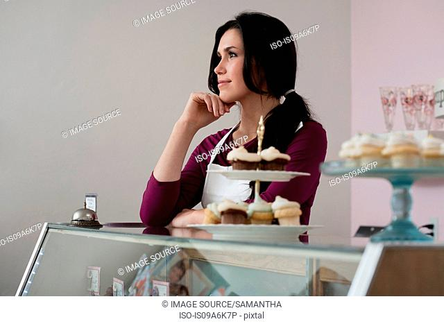 Baker standing behind counter