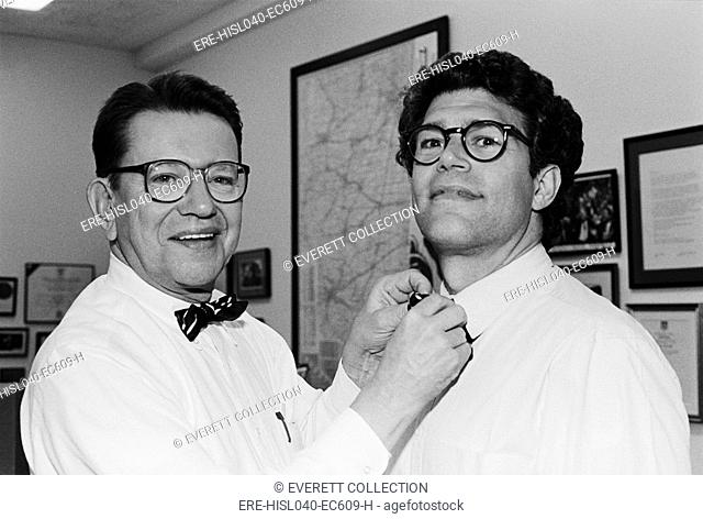 Senator Paul Simon straightens comedian and future Senator, Al Franken's bow tie. June 5, 1991. They were rehearsing for a Citizen Action dinner honoring Simon...