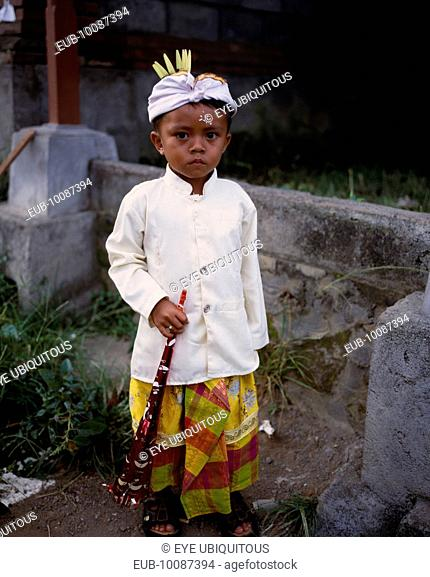 Young boy in traditional dress for Kuningan Festival