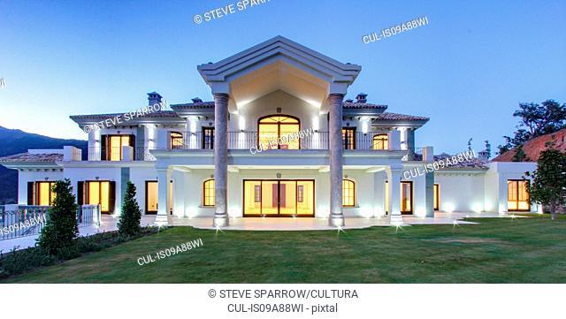 Illuminated luxury villa at dusk